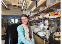 Emily Bayer is pictured at a lab bench