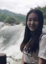 Xiaoting Li by a waterfall